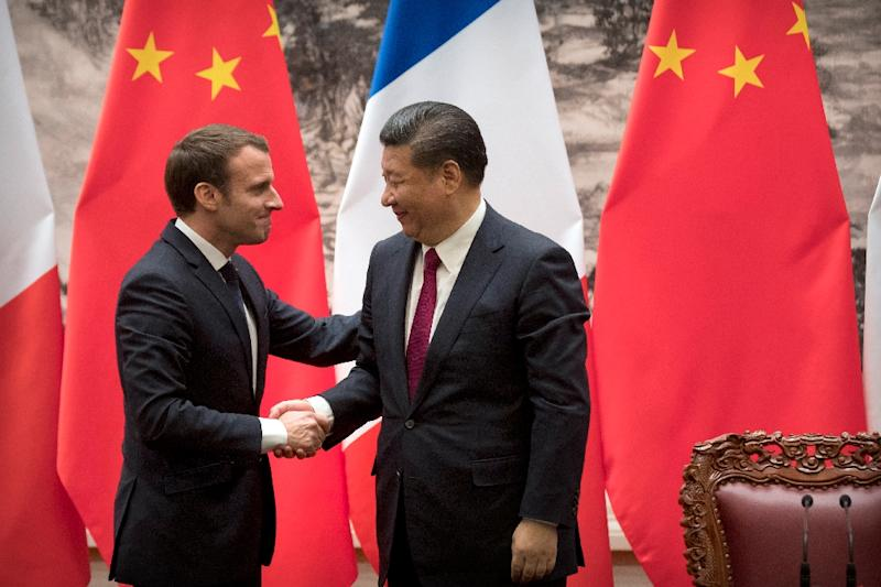 "French President Emmanuel Macron shakes hands with Chinese President Xi Jinping  following a joint press briefing in Beijing. Paris has been working for years to promote the safety of French beef, following the ""mad cow"" scare of the 1990s"