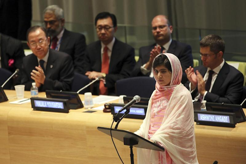 "United Nations Secretary-General Ban Ki-moon, left, applauds as Malala Yousafzai, right, addresses the 'Malala Day' Youth Assembly, Friday, July 12, 2013 at United Nations headquarters. Malala Yousafzai, the Pakistani teenager shot by the Taliban for promoting education for girls, celebrated her 16th birthday on Friday addressing the United Nations. The U.N. has declared July 12 ""Malala Day,"" to honor the teen who returned to school in March after medical treatment in Britain for injuries suffered in the October attack. (AP Photo/Mary Altaffer)"