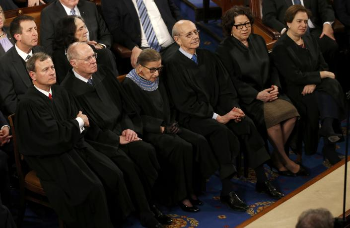 Ginsburg (third from left) listens to President Barack Obama's State of the Union address. (Reuters)