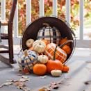 <p>Fall means there's plaid just about everywhere, and that includes your pumpkins! Get yourself some orange and white pumpkins and use duct tape to paint on the cozy designs.</p>