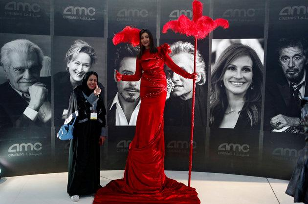 A woman poses at Saudi Arabia's first new commercial movie theater in Riyadh on April 18, 2018.