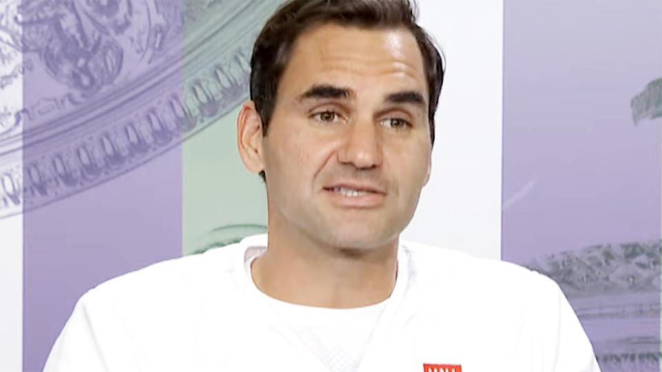 Roger Federer, pictured here in his post-match press conference at Wimbledon.