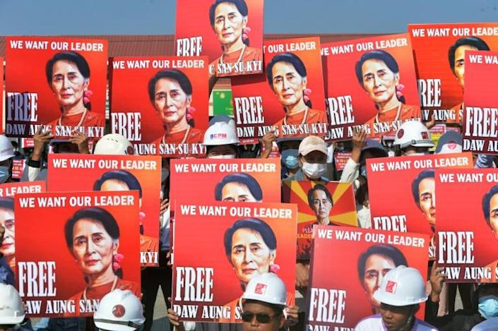 Protesting engineers held up signs calling for the release of Aung San Suu Kyi