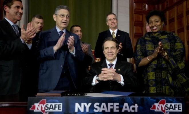 New York Gov. Andrew Cuomo and legislative leaders applaud after Cuomo signed New York's Secure Ammunition and Firearms Enforcement Act into law on Jan. 15.