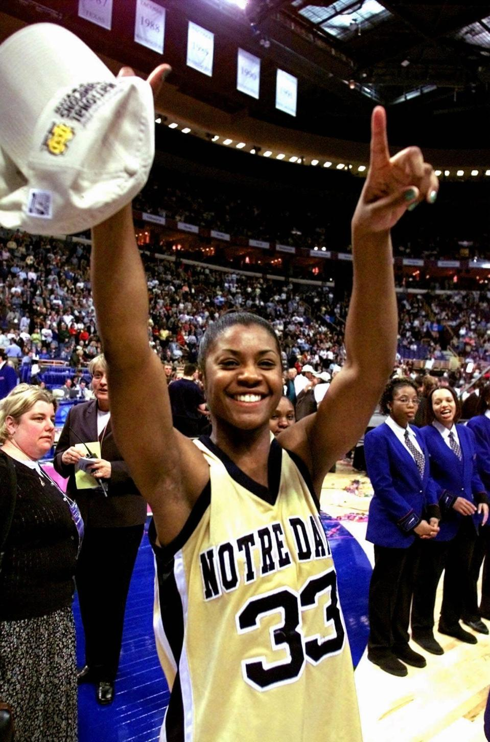 FILE - In this April 1, 2001, file photo, Notre Dame's Niele Ivey shows Notre Dame is Number 1 after they defeated Purdue 68-66 in the 2001 Women's Final Four Championship game in St. Louis. Ivey is ready to take over a Notre Dame program where she spent 17 years as a player and assistant coach. Ivey follows her mentor Muffet McGraw, who retired after 33 years at the school Wednesday, April 22, 2020. (AP Photo/Michael Conroy, File)