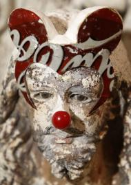 """A statue of Jesus Christ with Mickey Mouse ears and a clown nose is seen among the art installations exhibited at the Cultural Center of the Philippines in Manila August 8, 2011. An art installation that mixes Christ with kitschy symbols of pop culture and includes a crucifix with a movable penis has set off an uproar in the Philippines among conservative Catholics, who say the installations are a mockery of their faith. Mideo Cruz, the artist responsible for the installation -- intended to be a commentary on icon worship -- has been branded a """"demon"""" and bombarded with death threats and hate mail since his work featured in an exhibit in Manila that began June 17. REUTERS/Erik de Castro (PHILIPPINES - Tags: ENTERTAINMENT SOCIETY RELIGION)"""