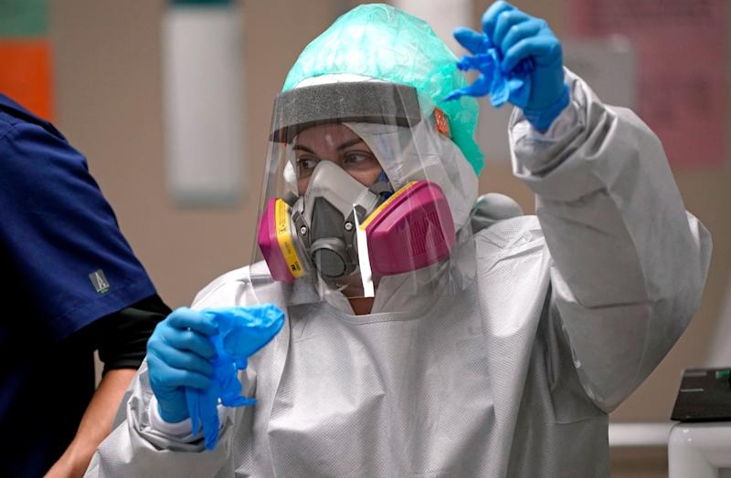 A registered nurse makes her way to a patient's room inside the coronavirus unit at Houston's United Memorial Medical Center. If the coronavirus is airborne, as many scientists say it is, health experts urge the use of masks and air filtration systems to help prevent virus transmission. (Photo: ASSOCIATED PRESS)