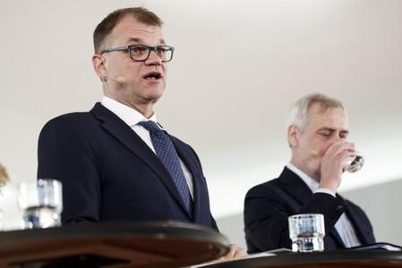 Centre Party Chairman Juha Sipila and Government Negotiator, Social Democratic Party Chairman Antti Rinne attend a news conference in Helsinki