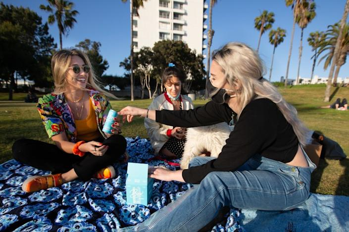 """Charlotte Cooper, left, Abby Hercules and Gaby Cutini, all of Los Angeles, celebrate Hercules' birthday at Ocean View Park in Santa Monica. <span class=""""copyright"""">(Jason Armond / Los Angeles Times)</span>"""