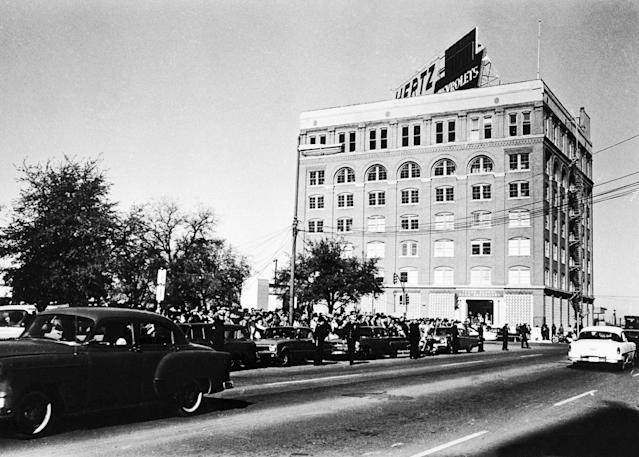 <p>A crowd awaits the presidential motorcade just prior to the assassination of President Kennedy at Dealey Plaza in Dallas, Texas. (Photo: Corbis via Getty Images) </p>