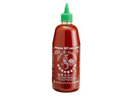 """<em>see-RAH-chah</em> A hot sauce, named after a city in Thailand, made up of chili peppers, distilled vinegar, garlic, sugar and salt. <strong>How to Use:</strong> Use as a dipping sauce and condiment. Or use in stir-fry sauces and marinades. <strong>Origin:</strong> Thailand. <strong>Recipe:</strong> <a href=""""http://www.huffingtonpost.com/2011/10/27/thai-spicy-peanut-sauce-w_n_1056965.html"""" rel=""""nofollow noopener"""" target=""""_blank"""" data-ylk=""""slk:Thai Spicy Peanut Sauce with Poached Chicken"""" class=""""link rapid-noclick-resp"""">Thai Spicy Peanut Sauce with Poached Chicken</a> <strong><a href=""""http://www.amazon.com/Huy-Fong-Sriracha-Chili-Sauce/dp/B000LO40AG/"""" rel=""""nofollow noopener"""" target=""""_blank"""" data-ylk=""""slk:Sriracha Hot Chili Sauce"""" class=""""link rapid-noclick-resp"""">Sriracha Hot Chili Sauce</a> at Amazon.com, $5.95</strong>"""