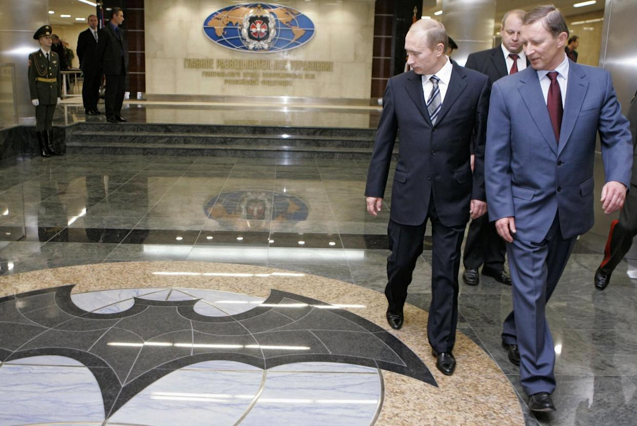 Russian President Vladimir Putin and Defense Minister Sergei Ivanov visit the Defense Ministry's Main Intelligence Directorate, known by its Russian acronym GRU, in Moscow. (Photo: ITAR-TASS, Dmitry Astakhov, Presidential Press Service/AP)