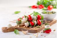 """<p>One of <a href=""""https://www.thedailymeal.com/25-romantic-little-foods-bring-picnic-date?referrer=yahoo&category=beauty_food&include_utm=1&utm_medium=referral&utm_source=yahoo&utm_campaign=feed"""" rel=""""nofollow noopener"""" target=""""_blank"""" data-ylk=""""slk:the best foods to pack for a picnic"""" class=""""link rapid-noclick-resp"""">the best foods to pack for a picnic</a>, these easy caprese skewers are a fresh and easily snackable side for any outdoor gathering.</p> <p><a href=""""https://www.thedailymeal.com/recipes/caprese-skewers-pesto-recipe?referrer=yahoo&category=beauty_food&include_utm=1&utm_medium=referral&utm_source=yahoo&utm_campaign=feed"""" rel=""""nofollow noopener"""" target=""""_blank"""" data-ylk=""""slk:For the Caprese Skewers With Pesto recipe, click here."""" class=""""link rapid-noclick-resp"""">For the Caprese Skewers With Pesto recipe, click here.</a></p>"""