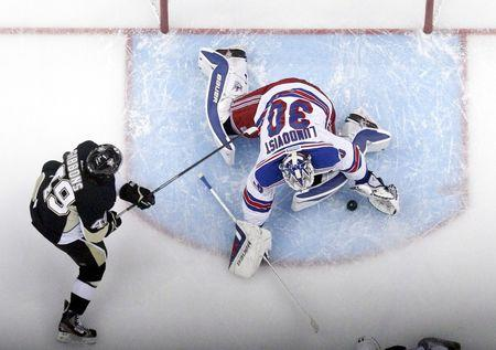 May 9, 2014; Pittsburgh, PA, USA; New York Rangers goalie Henrik Lundqvist (30) makes a save as Pittsburgh Penguins center Brian Gibbons (49) looks for a rebound during the first period in game five of the second round of the 2014 Stanley Cup Playoffs at the CONSOL Energy Center. The Rangers won 5-1. Mandatory Credit: Charles LeClaire-USA TODAY Sports