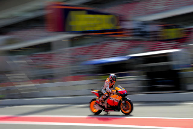 Repsol Honda Team's Australian Casey Stoner leaves the pits at the Catalunya racetrack in Montmelo, near Barcelona, on June 2, 2012, during the MotoGP third training session of the Catalunya Moto GP Grand Prix. AFP PHOTO / JOSEP LAGOJOSEP LAGO/AFP/GettyImages