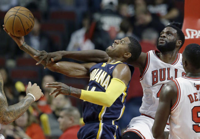 Indiana Pacers guard Paul George (24), left, shoots as Chicago Bulls center Nazr Mohammed (48) guards during the first half of an NBA preseason basketball game in Chicago on Friday, Oct. 18, 2013. (AP Photo/Nam Y. Huh)