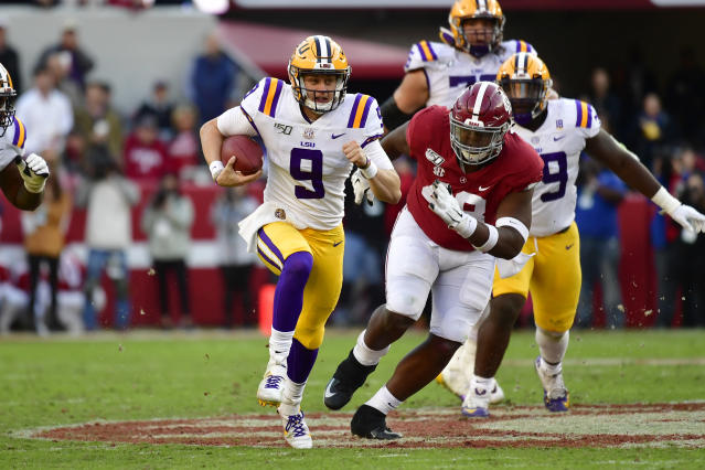 LSU quarterback Joe Burrow rushed for over 60 yards and threw for 393 in No. 2 LSU's win over No. 3 Alabama. (AP Photo/Vasha Hunt)