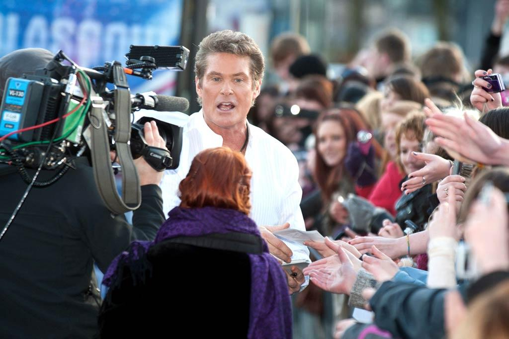 """""""Britain's Got Talent's"""" newest judge, David Hasselhoff, was greeted by throngs of fans upon arriving at Glasgow, Scotland's Clyde Auditorium in search of contestants. """"I am just looking for talent,"""" he said. """"I don't care what it is. If it's a dog, a cat, a dancing act."""" <a href=""""http://www.PacificCoastNews.com"""" target=""""new"""">PacificCoastNews.com</a> - January 18, 2011"""