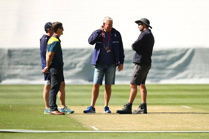 Officials are seen speaking with the curator, as play is abandoned due to an unsafe pitch prior to the start of day two of the Sheffield Shield match between Victoria and Western Australia at Melbourne Cricket Ground on December 08, 2019 in Melbourne, Australia.
