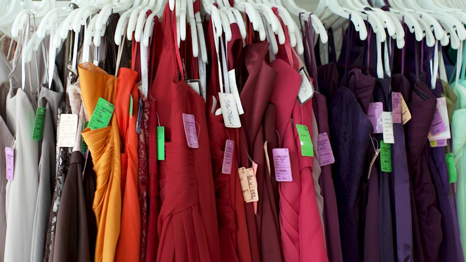 Bridesmaid dresses hanging on RK Bridal's racks. (Source: Yahoo Finance)