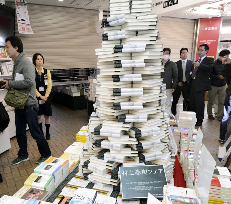 """Copies of the book """" Colorless Tsukuru Tazaki and his years of pilgrimage, """" the latest novel by Haruki Murakami are piled high at a book store in Tokyo Friday, April 12, 2013. Murakami's new novel, first in three years, went on sale on Friday. (AP Photo/Kyodo News)"""