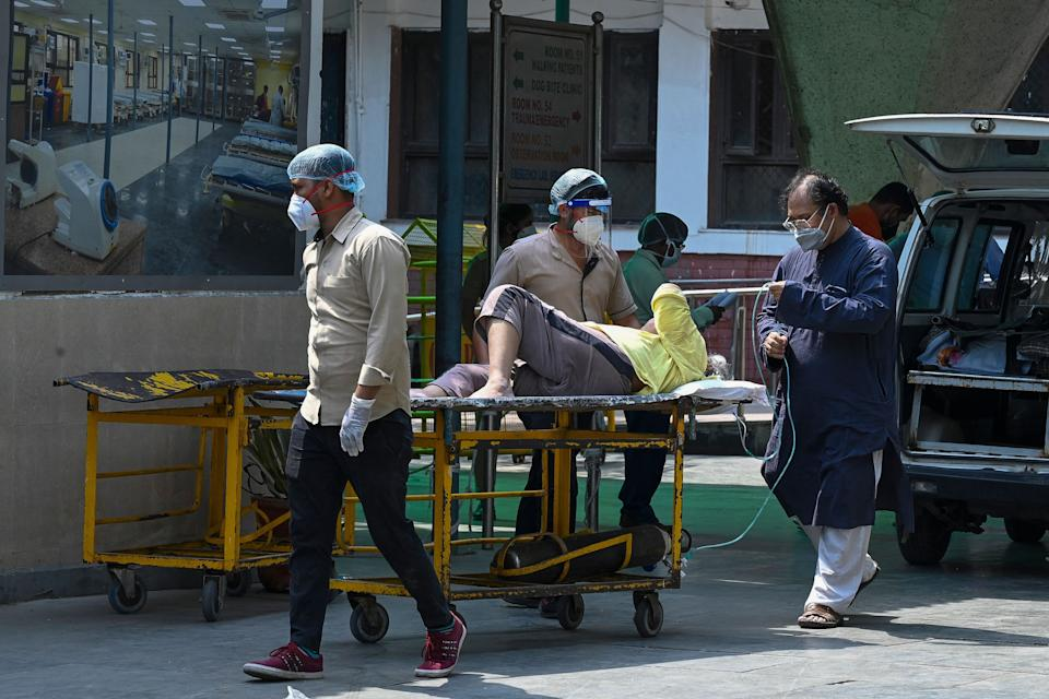 A Covid-19 coronavirus patient arrives for admission at the GTB hospital in New Delhi.