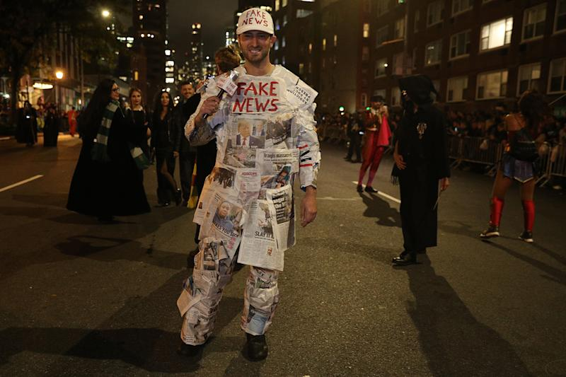 "A reveler wearing a ""Fake News"" costume marches during Halloween Parade in New York City. (Photo: Gordon Donovan/Yahoo News)"