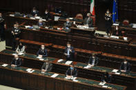Premier Giuseppe Conte, center, delivers his speech at the lower chamber of Parliament, in Rome, Monday, Jan. 18, 2021. Conte fights for his political life with an address aimed at shoring up support for his government, which has come under fire from former Premier Matteo Renzi's tiny but key Italia Viva (Italy Alive) party over plans to relaunch the pandemic-ravaged economy. (AP Photo/Alessandra Tarantino, pool)