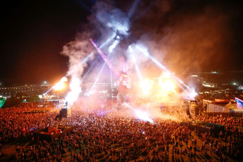 FILE PHOTO: Festival goers in the late night Arcadia area during Glastonbury Festival in Somerset