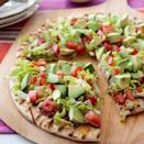 """<p>This dip is ready in 15 minutes and uses game day-friendly ingredients like avocado and black beans.</p><p><a href=""""https://www.goodhousekeeping.com/food-recipes/a9630/mexican-pizza-recipe/"""" rel=""""nofollow noopener"""" target=""""_blank"""" data-ylk=""""slk:Get the recipe for Mexican Pizza »"""" class=""""link rapid-noclick-resp""""><em>Get the recipe for Mexican Pizza »</em></a></p>"""