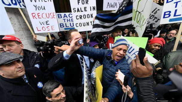 PHOTO: Dueling protestors clash over Cook County State's Attorney Kim Foxx's office's decision to drop all charges against 'Empire' actor Jussie Smollett, April 1, 2019, in Chicago. (Paul Beaty/AP)