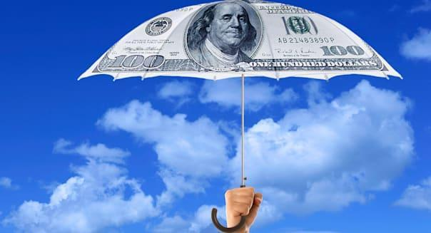 A hand holding an umbrella with paper money design