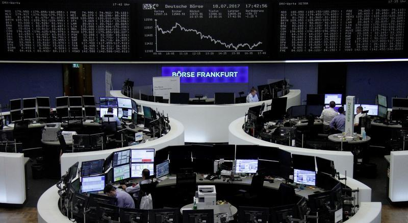 Traders Work In Front Of The German Share Price Index DAX Board At