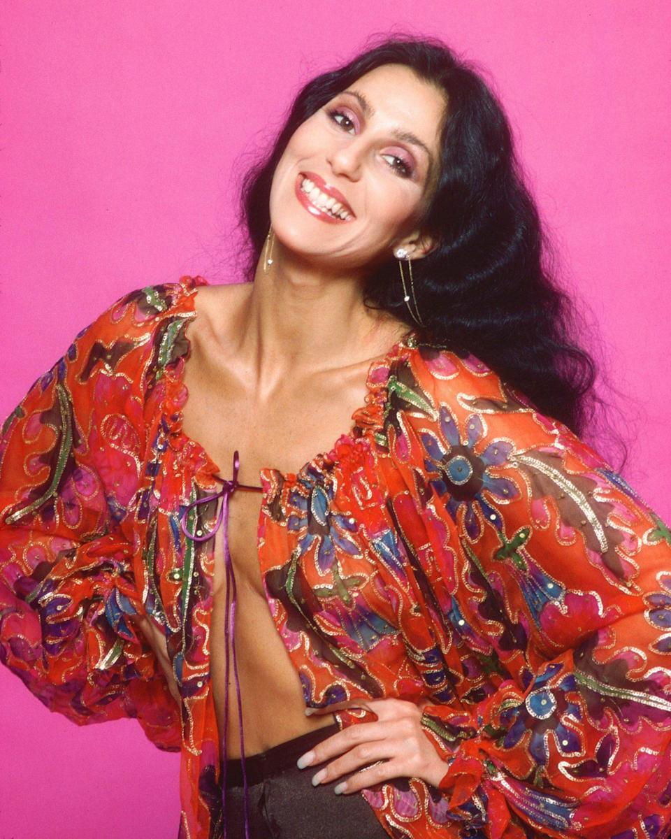 <p>... for this look! Somehow, Cher managed to make a peasant blouse look impeccably sexy in 1977.</p>