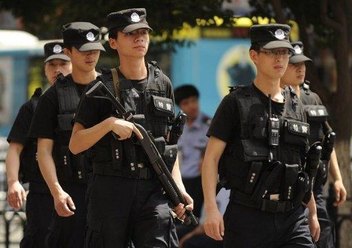 Chinese police patrol a street in Urumqi, the capital of the restive Xinjiang region