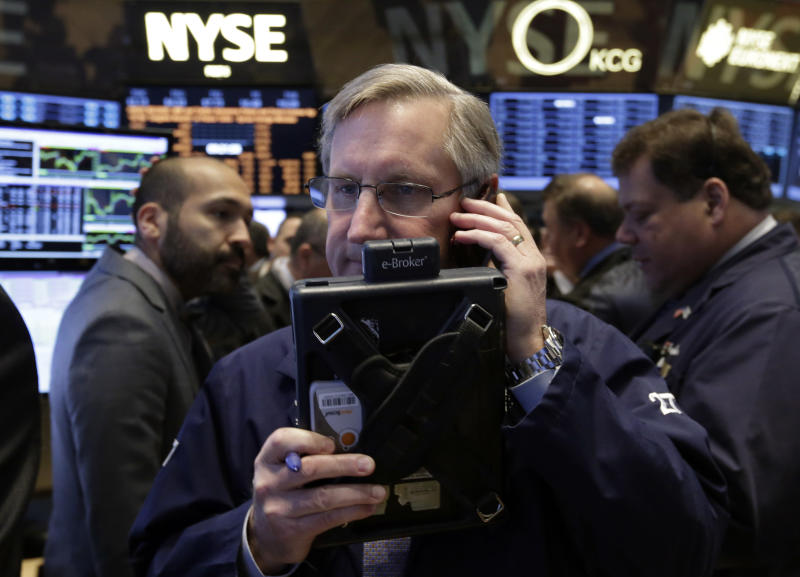 Trader Christopher Fuchs, center, works on the floor of the New York Stock Exchange Friday, Jan. 31, 2014. Stocks fell sharply in early trading Friday, as investors fretted over disappointing earnings from companies like Amazon.com and more trouble in overseas markets. (AP Photo/Richard Drew)
