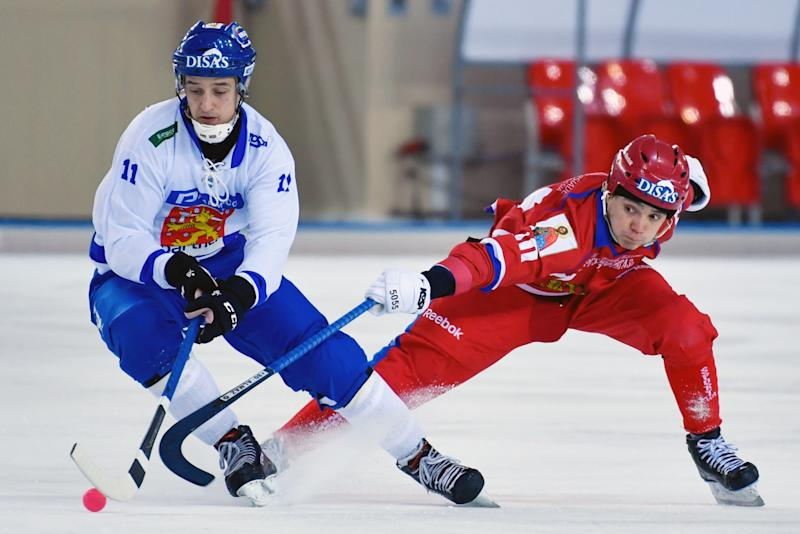 Finnish and Russian hockey players compete in the 2018 Bandy World Championship semi-final match in Khabarovsk, Russia. (Yuri Smityuk via Getty Images)