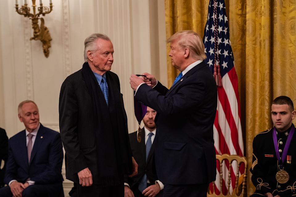 WASHINGTON, DC - NOVEMBER 21: President Donald J. Trump awards the National Medal of Arts to actor Jon Voight in the East Room at the White House on Thursday, November 21, 2019, in Washington, D.C. (Photo by Salwan Georges/The Washington Post via Getty Images)