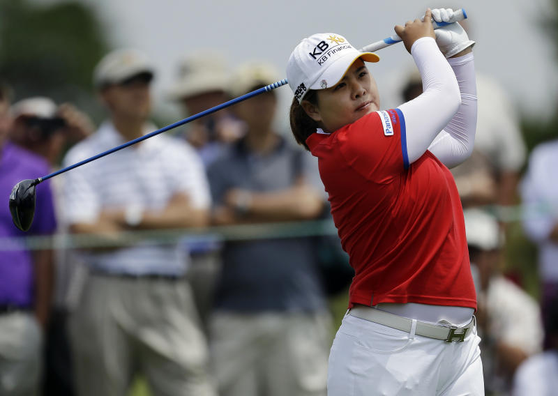 Inbee Park, of South Korea, tees off on the first hole during the third round of the U.S. Women's Open golf tournament at the Sebonack Golf Club Saturday, June 29, 2013, in Southampton, N.Y. (AP Photo/Frank Franklin II)