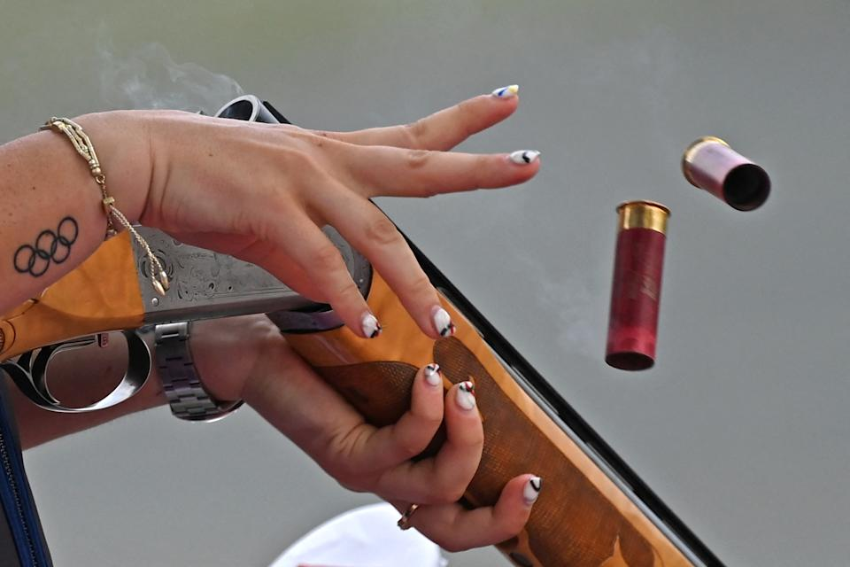<p>A tattoo of the Olympic rings are seen on the wrist of USA's Kayle Browning as she competes in the women's trap qualification during the Tokyo 2020 Olympic Games at the Asaka Shooting Range competes in the Nerima district of Tokyo on July 29, 2021. (Photo by Tauseef MUSTAFA / AFP)</p>