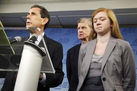 Abigail Fisher (R), a suburban Houston student who asserted she was wrongly rejected by the University of Texas at Austin while minority students with similar grades and test scores were admitted thanks to the admissions policy, and her father Richard Fisher (C) stand by as Edward Blum, director of the Project on Fair Representation, speaks at a news conference in Washington, June 24, 2013. REUTERS/Jonathan Ernst