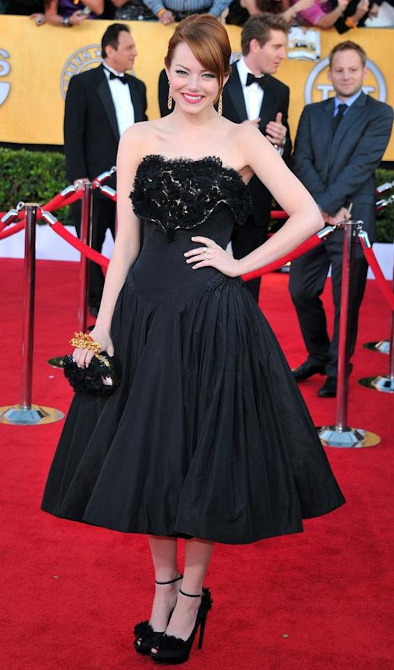 """Emma Stone was all smiles upon arriving at the 18th Annual Screen Actors Guild Awards at The Shrine Auditorium in Los Angeles, California. The actress -- whose film, """"The Help,"""" took top honors -- looked cute as can be in a black Alexander McQueen cocktail frock and matching, bow-adorned peep-toes."""