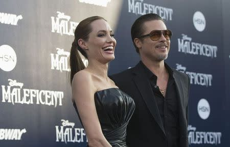 "Cast member Jolie and actor Pitt pose at the premiere of ""Maleficent"" at El Capitan theatre in Hollywood"