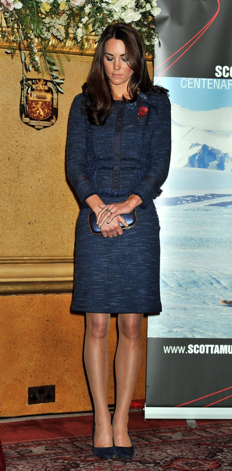 <p>For a London reception, Kate chose a navy tweed jacket and skirt by Rebecca Taylor. She accessorised with blue Prada pumps and a shiny Anya Hindmarch clutch. </p><p><i>[Photo: PA]</i></p>