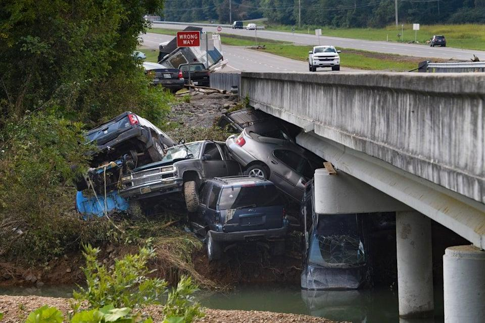 Smashed cars sit in a heap after the deadly flooding in Tennessee (Copyright 2021 The Associated Press. All rights reserved)
