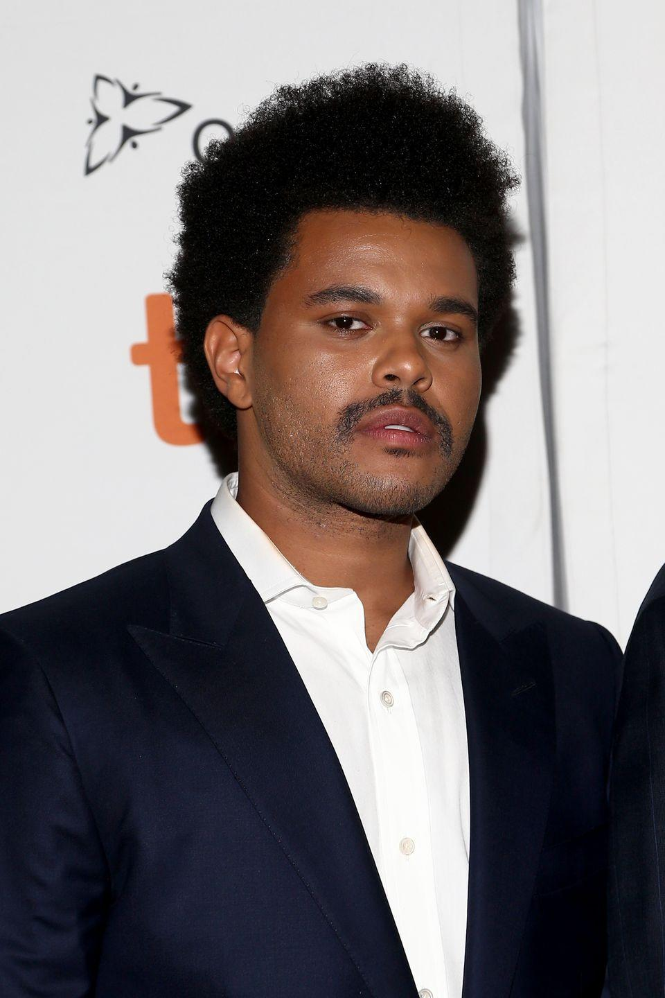 <p>The most jarring thing about The Weeknd's September 2019 look? The mustache that replaced his signature trimmed beard. The short fro was brand new as well. </p>
