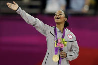 <p>Gabrielle Douglas receives her gold medal in the artistic gymnastics women's individual all-around competition at the 2012 Summer Olympics in London. (AP Photo/Gregory Bull, File) </p>