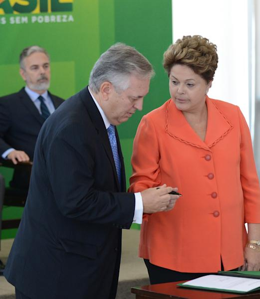 In this photo released by Agencia Brasil, Brazil's President Dilma Rousseff, right, attends the swearing-in ceremony of newly named Foreign Minister Luiz Alberto Figueiredo, left, at the Planalto palace, in Brasilia, Brazil, Wednesday, Aug. 28, 2013. The smuggling of a Bolivian dissident into the country by a Brazilian diplomat may have prompted the ouster of Foreign Minister Antonio Patriota, left back, but analysts said Tuesday it was just the last straw for his strained relationship with the president. (AP Photo/Agencia Brasil, Antonio Cruz)