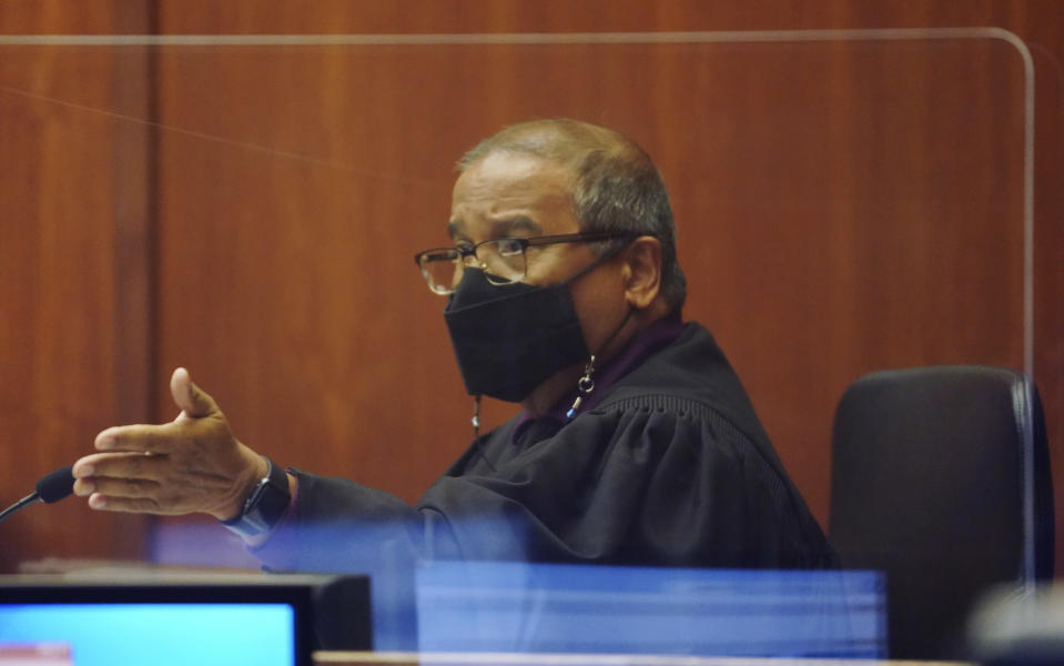 Judge William Domingo presides over a preliminary hearing as he hears from witnesses to determine whether there is probable cause for murder and attempted murder charges against three Honolulu police officers in a shooting that killed a 16-year-old Micronesian boy, Tuesday, July 20, 2021, in Honolulu. (Cory Lum/Honolulu Civil Beat via AP, Pool)