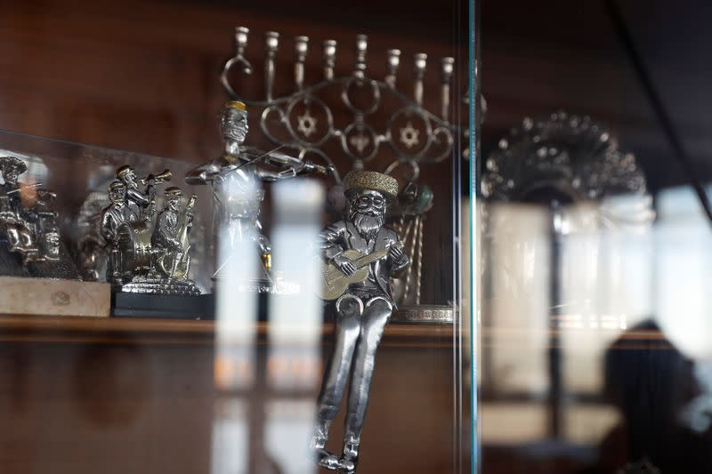 A menorah and other Judaica sit in a cabinet at Lea and Yehuda Evron's apartment in the Queens borough of New York